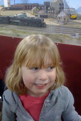 Lauren watches a model train go by