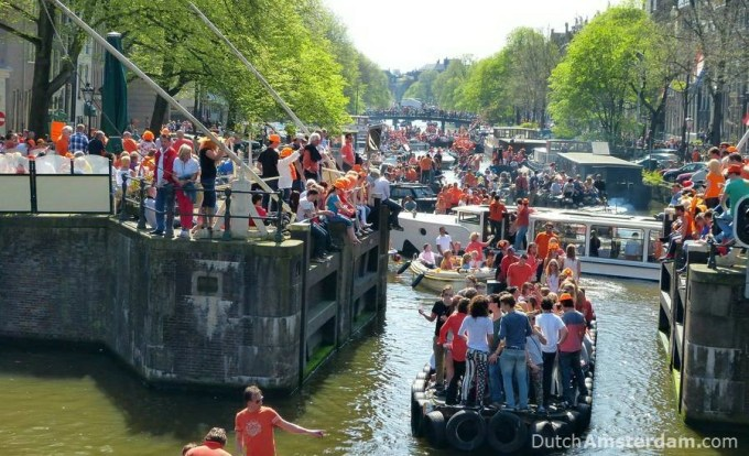 On King's Day in Amsterdam thousands of people take to the canals