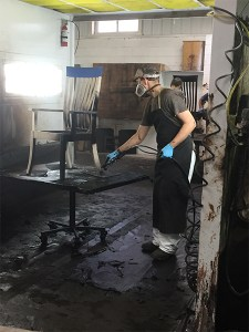 Applying stain at Shclabach Finishing Shop.