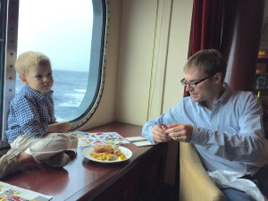 Enjoying pub lunch with an ocean view on the QM2.