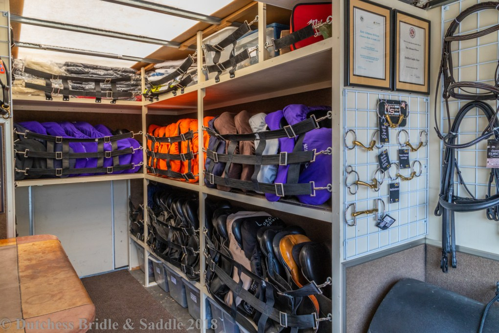 Dutchess Bridle & Saddle truck interior with demo and consignment saddles.