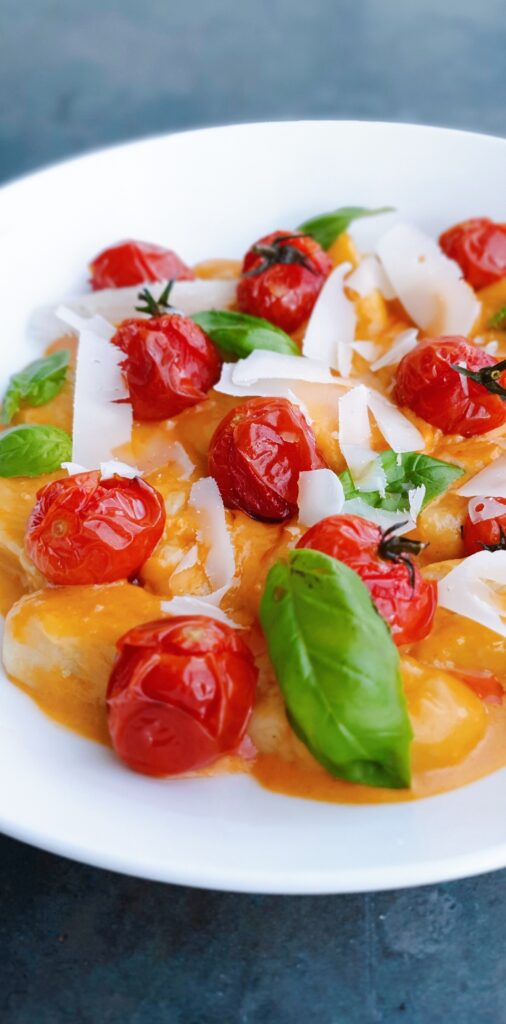 Gnocchi, creamy tomatoes, basil