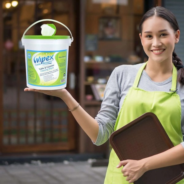 Waitress holding Table Bussers Wipes Bucket