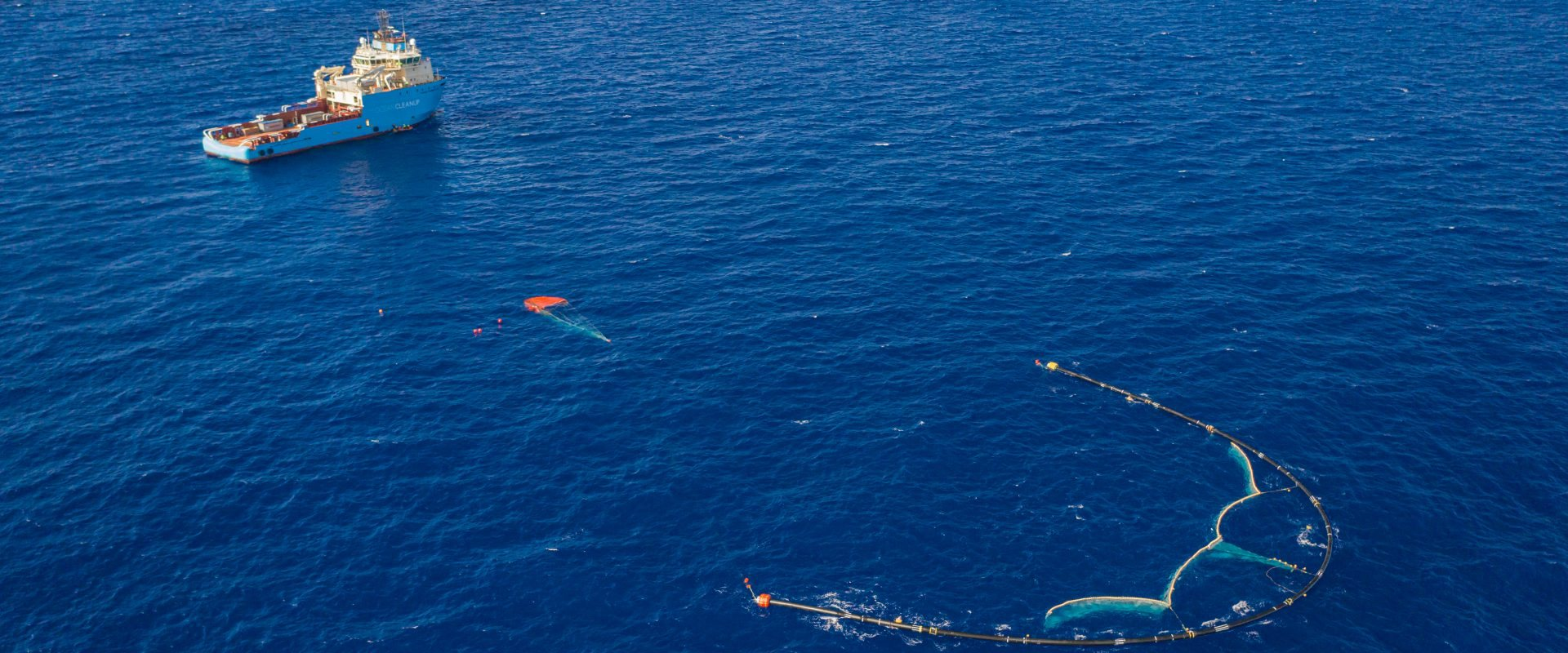The ocean cleanup uses machine learning to identify plastic pollution in rivers and simulate how it moves in the ocean. Ocean Cleanup Deploys Parachute To Slow Down Trash Collecting Barrier Dutch Water Sector