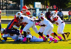 Trojans D-Line pushing the ball carrier behind the line of scrimmage