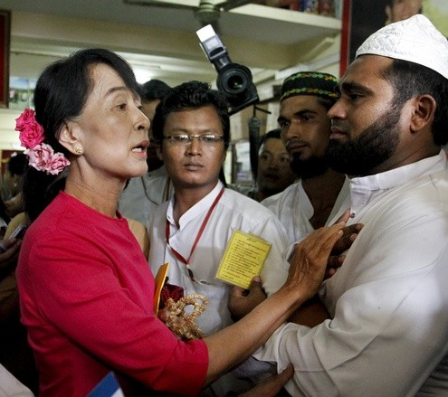 Myanmar's pro-democracy leader Aung San Suu Kyi talks to Myanmar Muslims leaders at the National League for Democracy head office in Yangon