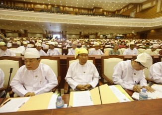 Members of parliament attend the opening of the lower house session in Naypyidaw on 4 July 2012. (Reuters)