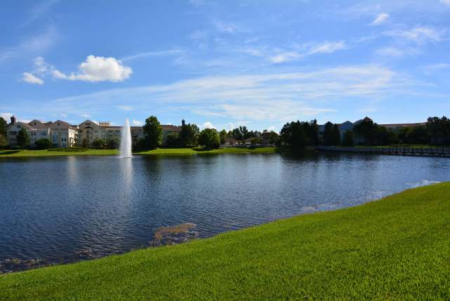 Disney's Saratoga Springs from across a lake with a fountain