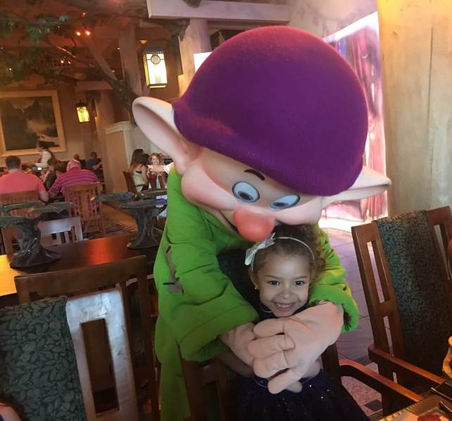 Dopey Dwarf hugging a little girl at the Wilderness Lodge Resort