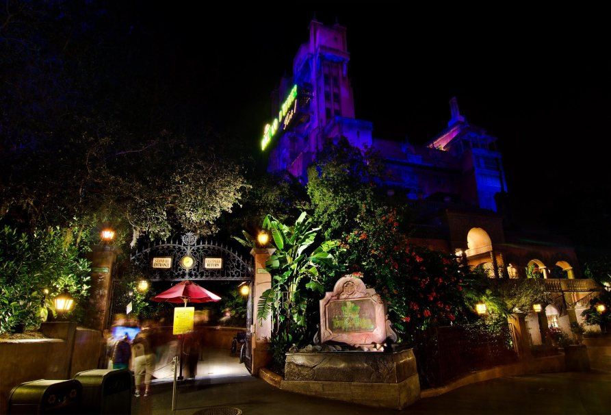 Tower of Terror at night lit in blue and purple light