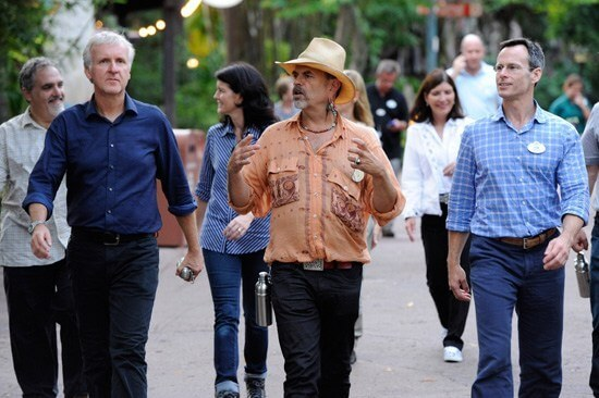 Famous Imagineer Joe Rohde walking with Cast Members at Walt Disney World