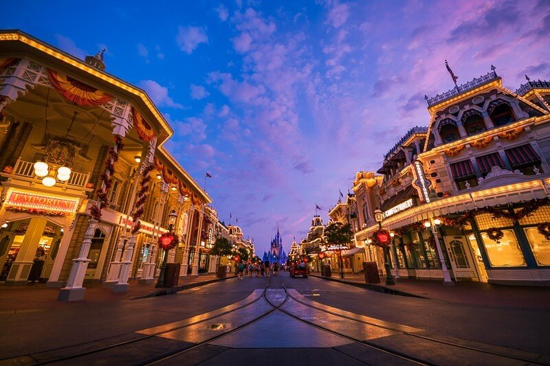 Bulidings with white lights at dawn on main street at the magic kingdom at disney world
