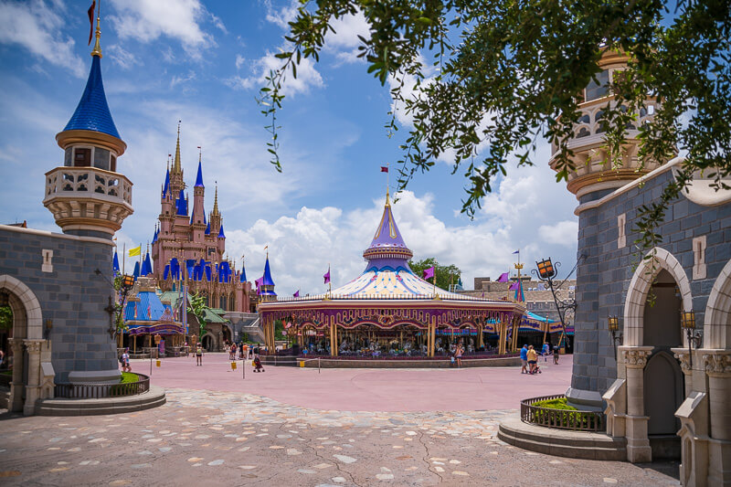 Disney's Magic Kingdom view with Cinderella Castle and Prince Charming Carousel