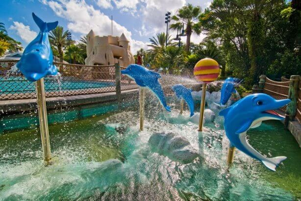 Water, bridge, sandcastle, and dolphins outside of Olivias Cafe at DVC Old Key West