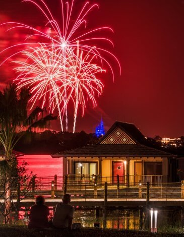 Disney's Polynesian Resort at night with fireworks overhead