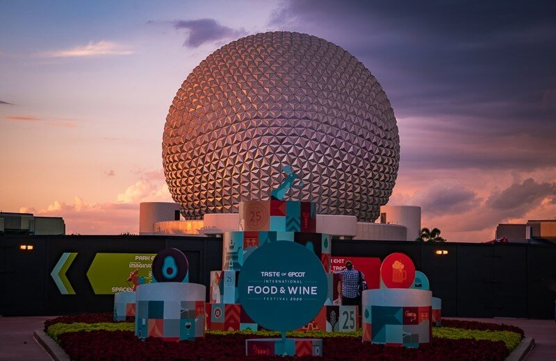 EPCOT pictured with Food and Wine festival sign at sunset