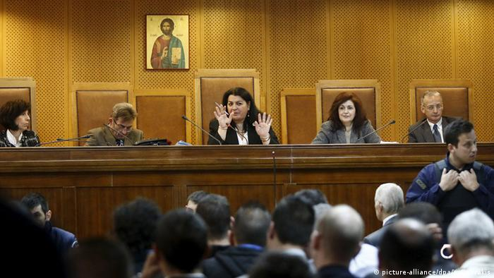 courtroom copyright: REUTERS/Yannis Behrakis