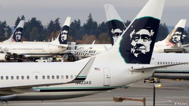 Airlines logo showing a smiling Eskimo face on the tails of Alaska Airline airplanes (Reuters)