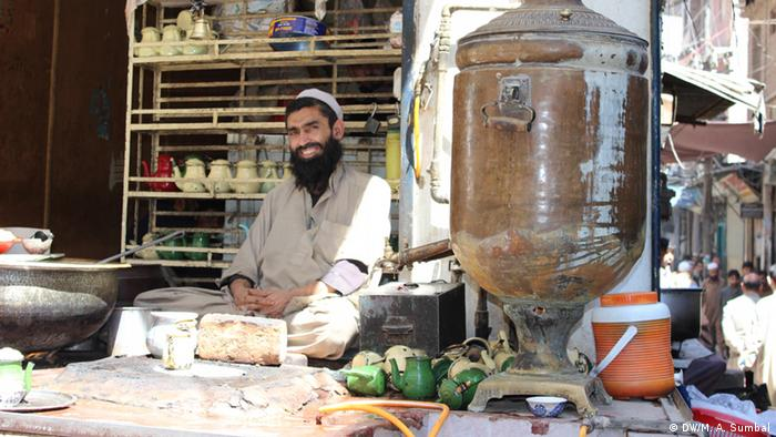 A man selling tea on his stall in Jhangi Mohalla of Peshawar.