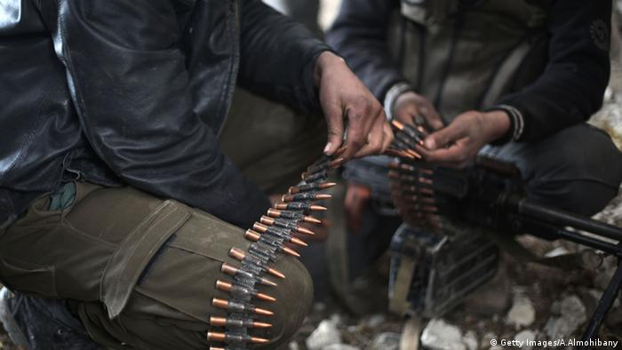 Fighters from rebel factions in Damascus prepare their ammunition (Getty Images/A.Almohibany)