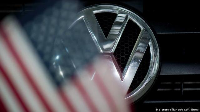 US flag in front of the VW sign