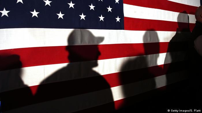 Shadows on a US flag (Getty Images/S. Platt)