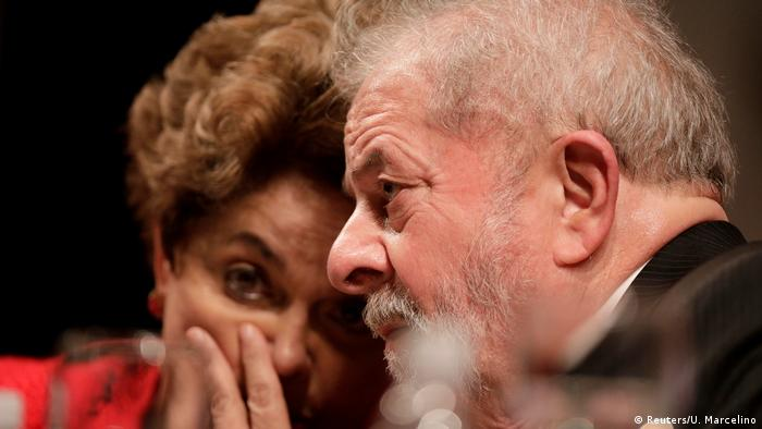 Former Brazilian President Luiz Inacio Lula da Silva speaks with former Brazilian President Dilma Rousseff during the inauguration of the new National Directory of the Workers' Party, in Brasilia (Reuters/U. Marcelino)
