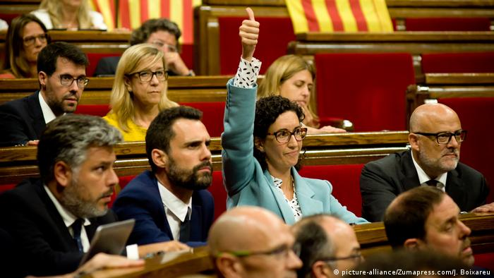 A member of the Catalonia parliament gives a thumbs up in a September 6 vote to pursue an independece referendum.