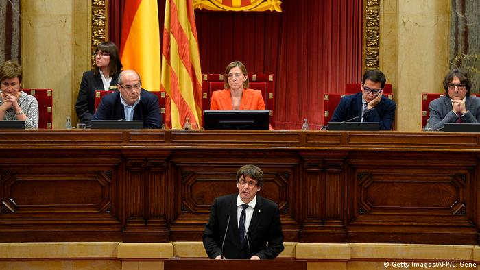 Carles Puigdemont gives a speech at the Catalan regional parliament in Barcelona