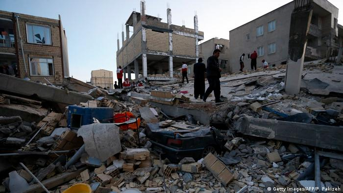 Rescue personnel conduct a search in Iran's Kermanshah province, after it was struck by a 7.3 magnitude earthquake (Getty Images/AFP/P. Pakizeh)