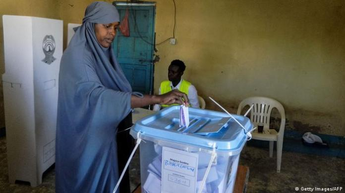 Woman casting ballot (Getty Images/AFP)