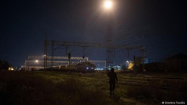 A man walks toward the train