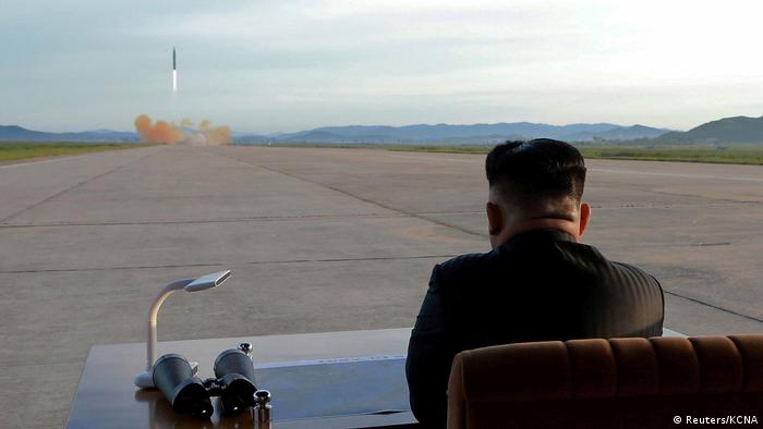 North Korean leader Kim Jong Un watching the launch of a Hwasong missile