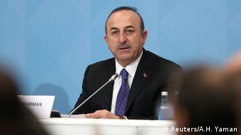 Turkish Foreign Minister Mevlut Cavusoglu speaks during a meeting
