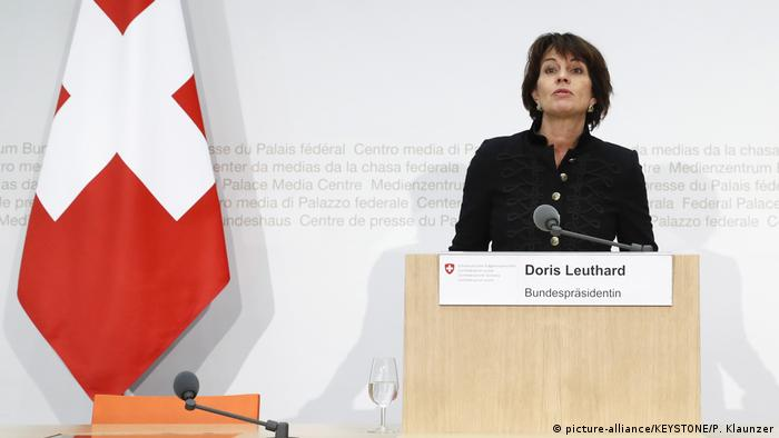 Swiss President Doris Leuthard talks from behind lecturn.