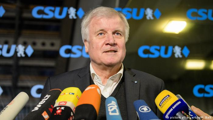 CSU chief Horst Seehofer talking to reporters