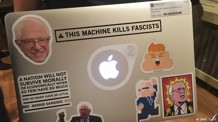 A socialist activist carries his laptop at a Washington, D.C., DSA meeting