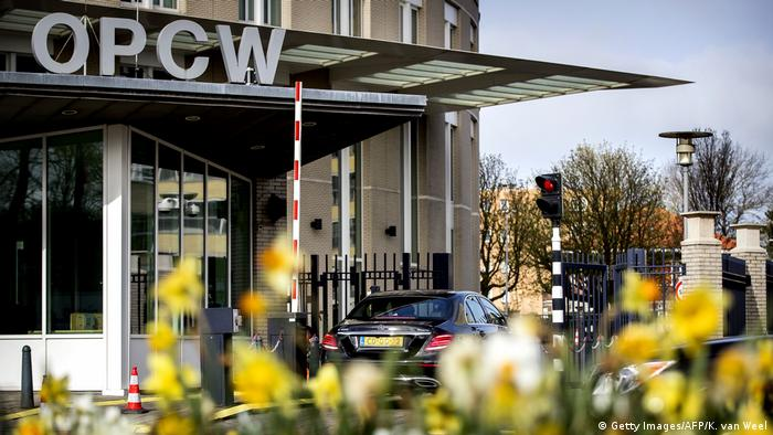 A car drives through the entrance barrier at the OPCW (Getty Images/AFP/K. van Weel)