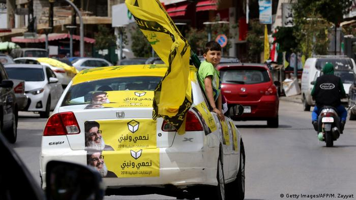 Supporters of Hezbollah drive in the city of Nabatieh in southern Lebanon (Getty Images/AFP/M. Zayyat)