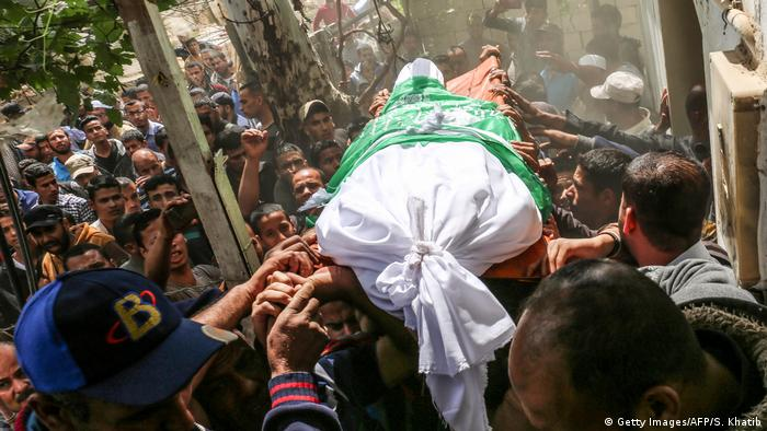 One of the bodies being carried at a Gaza funeral (Getty Images/AFP/S. Khatib)