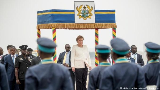 German Chancellor Angela Merkel is greeted by the military during her stopover in Accra, Ghana.