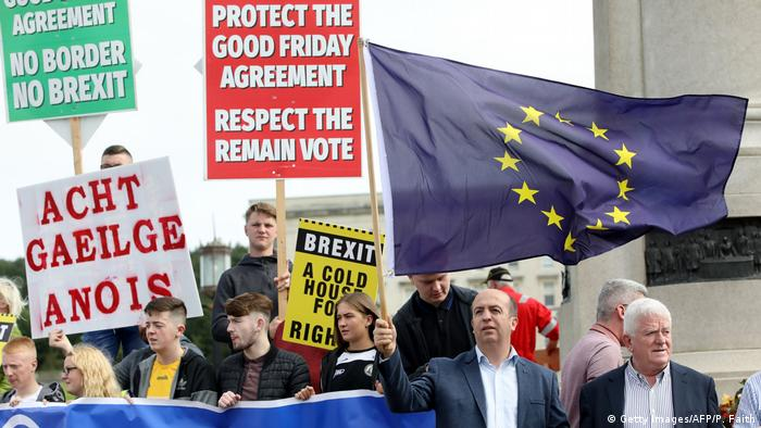 Anti-Brexit demonstrators protest outside Stormont house as Britain's Prime Minister Boris Johnson visits Belfast, Northern Ireland (Getty Images/AFP/P. Faith)