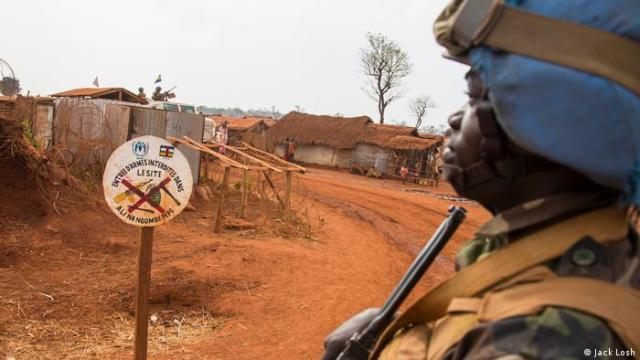 A UN peacekeeper heads out on patrol through a displacement camp in the eastern, rebel-held town of Bria. (Jack Losh)