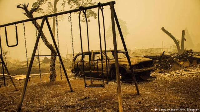 A burned out car and playbroung in Oregon