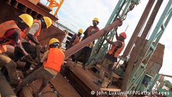Workers constructing a modern bridge Photo.JOHN LUKUWI/AFP/Getty Images)
