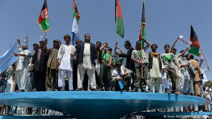 Supporters of Afghan presidential candidate Abdullah Abdullah shout slogans during a demonstration in Kabul on June 27, 2014. Afghan presidential candidate Abdullah Abdullah led thousands of demonstrators at a noisy rally through Kabul on June 27, upping the stakes in his protest against alleged election fraud that has triggered a political crisis. Abdullah has vowed to reject the election result, saying he was the victim of massive ballot-box stuffing in the June 14 election with vote counting reportedly putting him far behind his poll rival Ashraf Ghani. AFP PHOTO/SHAH Marai (Photo credit should read SHAH MARAI/AFP/Getty Images)