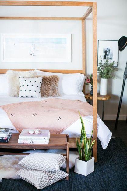 modern bohemian bedroom - wooden bed frame