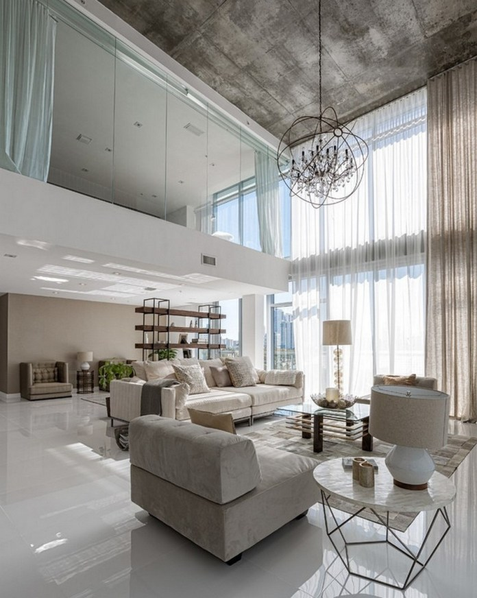 open-living-room-coupled-with-loft-featuring-floor-to-ceiling-window-with-transparent-curtain-and-hanging-crystal-chandelier