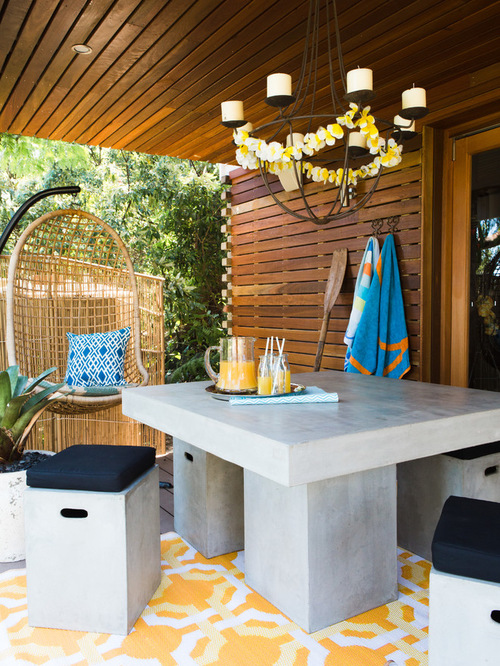Beach Style Outdoor Design Ideas with concrete outdoor seating