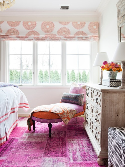 Beach style eclectic bedroom design featuring pink rugs and unique decor ideas.